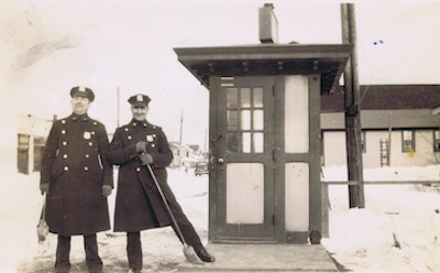 two policemen standing guard in the 1940s